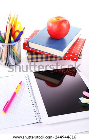 Pile of books with tablet on white background - stock photo