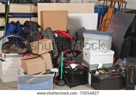 Pile of boxes junk inside a residential garage. - stock photo