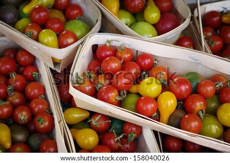 Pile of boxes of beautiful red an yellow cherry tomatoes  - stock photo