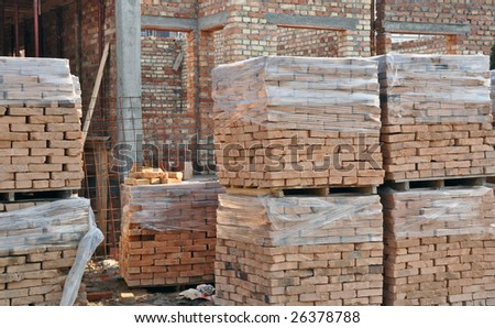 Building a private house, construction site. Bricks and other construction