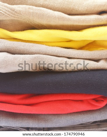 pile of bright new clothes - stock photo