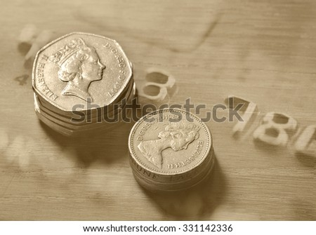 Pile of british coins with shallow depth of field.