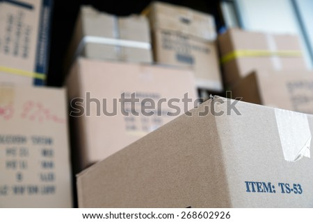 Pile of brown cardboard boxes at warehouse of market. Different stuff packed in carton boxes. Moving concept. Set of cargo boxes ready for delivery. - stock photo