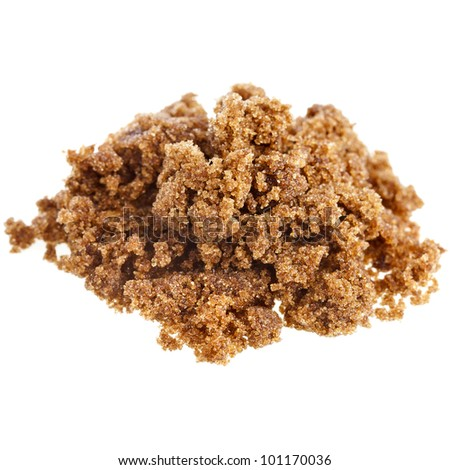 pile of brown dark sugar on white background - stock photo