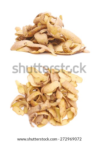 Pile of brown potato peels isolated over the white background, set of two foreshortenings - stock photo
