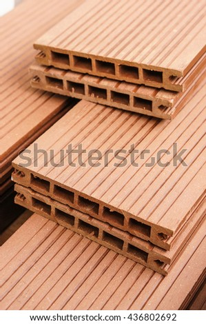 Pile of brown wood-plastic composites - stock photo