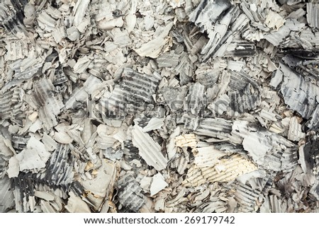 Pile of burnt corrugated paper. Close up. - stock photo