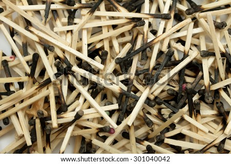 pile of burnt matches on a white background