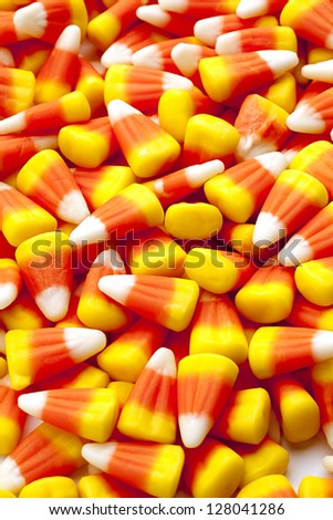 Pile of candy corn for background image. - stock photo