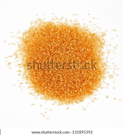 Pile of cane sugar on white background - stock photo