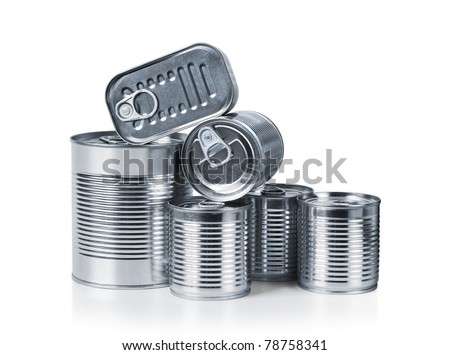 Pile of cans of conserved food over white background - stock photo