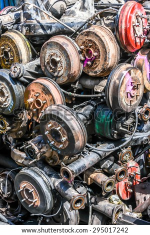 pile of car parts for recycling - chassis - stock photo
