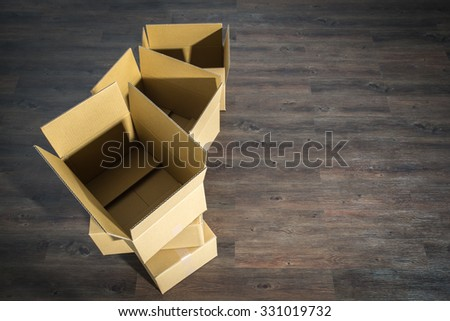 Pile of cardboard boxes on parquet  home relocation, nobody