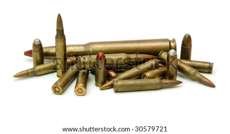 Pile of cartridges of various calibers isolated - stock photo