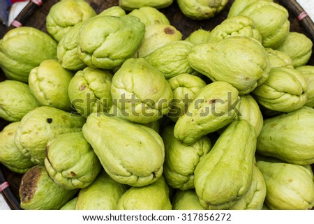 Pile of chayote fruits for sale in Vietnam - stock photo