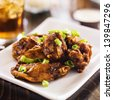 pile of chicken wings on plate. - stock photo