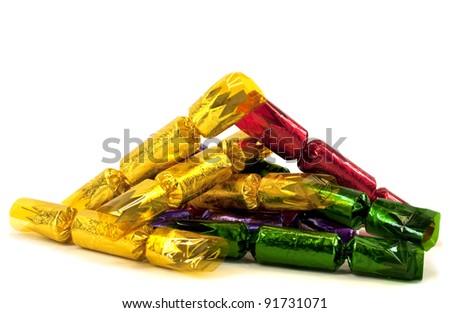 Pile of christmas crackers isolated on white background - stock photo