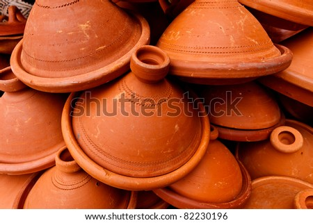 Pile of clay tangine cooking pots in Medina, marketplace, Meknes, Morocco.
