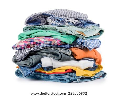 pile of clothing isolated on white - stock photo