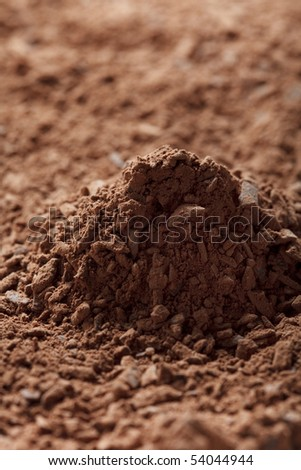 pile of cocoa powder with small pieces of chocolate  background, shallow DOF