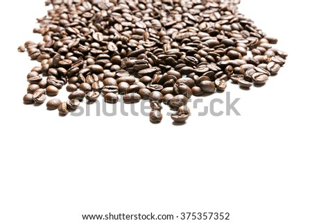 pile of coffee beans isolated on white background - stock photo