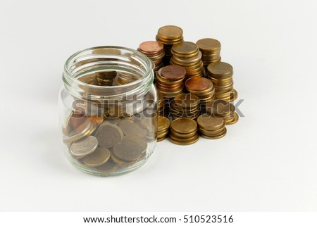 Pile of coins isolated on white background