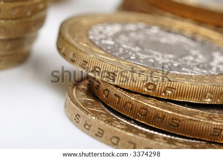 pile of £2 coins, uk currency - stock photo