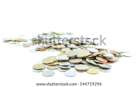 Pile of coins with blue filter - stock photo