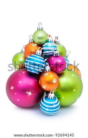Pile of colorful Christmas balls or bauble decorations; isolated on white background. - stock photo