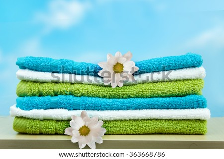 Pile of colorful clean towels. - stock photo