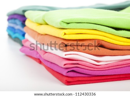 Pile of colorful clothes - stock photo