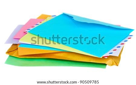 pile of colorful envelopes isolated on white background - stock photo