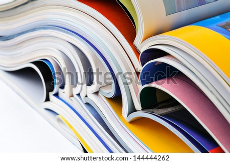 Pile of colorful magazines - stock photo