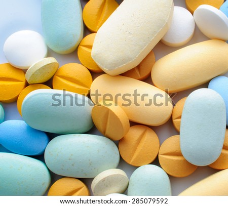 Pile of colorful pills drugs and tablets - stock photo