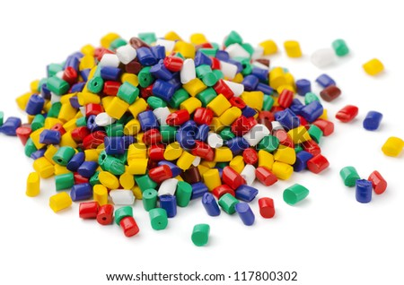 Pile of colorful plastic polymer granules isolated on white - stock photo