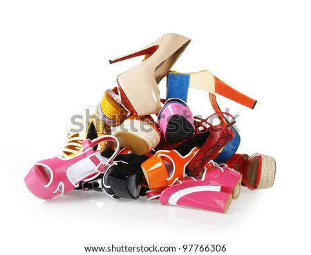 pile of colorful shoes on white background - stock photo