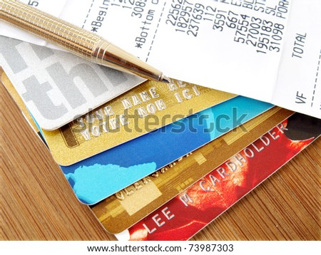 Pile of credit cards with pen and receipt. - stock photo