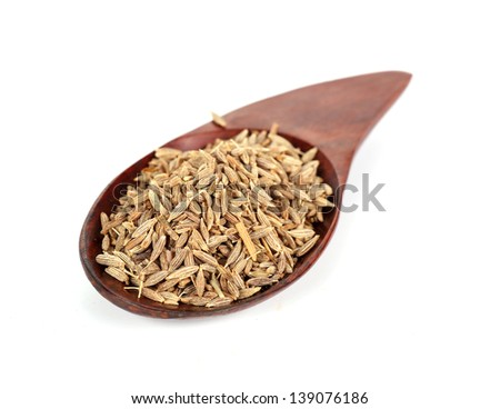 Pile of cumin seeds captured from above isolated on white