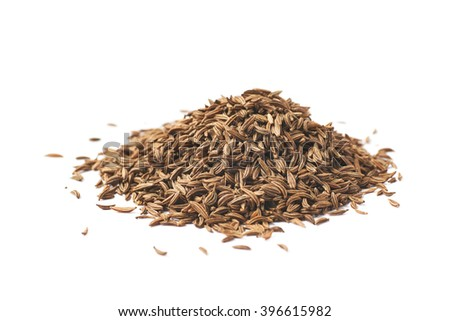 Pile of cumin seeds isolated - stock photo