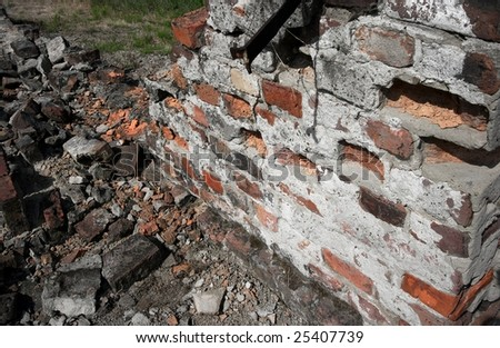 Pile of debris of ruined brick wall of a building - stock photo