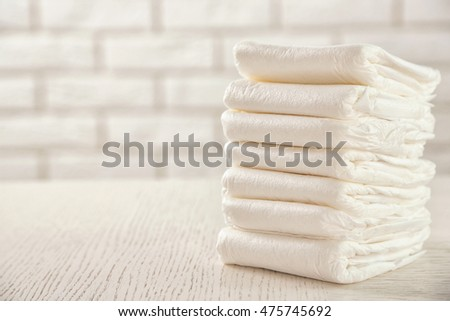 Pile of diapers on the table