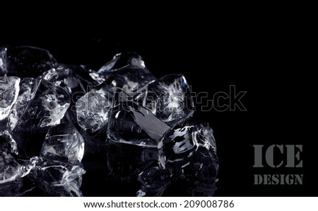 pile of different ice cubes on black background - stock photo