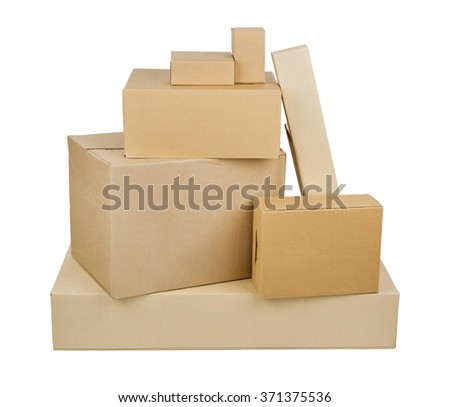 Pile of different size cardboard boxes isolated on white background - stock photo