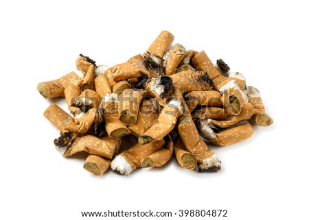 Pile of dirty cigarette butts isolated on white background - stock photo