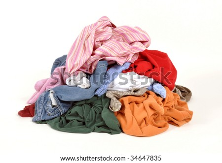 Pile of dirty clothes for the laundry - stock photo