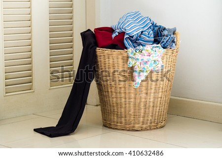 Pile of dirty clothes in a washing basket - stock photo