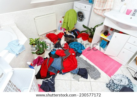 pile of dirty clothes ready for the wash in home bathroom - stock photo