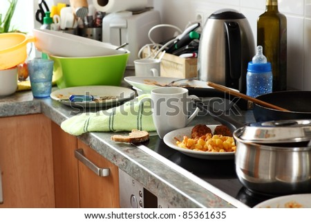 Pile of dirty dishes in the kitchen - Compulsive Hoarding Syndrom - stock photo