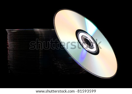 Pile of disks with colorful light reflection - stock photo