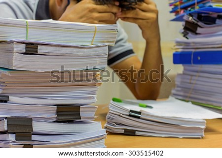 Pile of documents on desk for managed. - stock photo